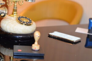 notary the table with the phone